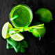 Blended green smoothie with ingredients on black table. - PhotoDune Item for Sale