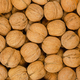 Walnuts background close up, pile of unshelled nuts - PhotoDune Item for Sale