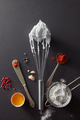A set of knife with pepper, sieve with flour, metal whisk and boiled eggs on a black concrete - PhotoDune Item for Sale