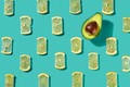 Pattern made of lemon slices and half avocado on a blue background. Food background. Flat lay - PhotoDune Item for Sale