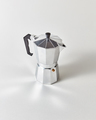 Traditional metal Italian coffee maker presented on a gray background with copy space - PhotoDune Item for Sale