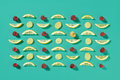 Ripe raspberry and lemon slices pattern of fruit on a blue background. Food layout. Flat lay - PhotoDune Item for Sale