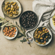 Mediterranean pickled olives and olive tree branches on grey background - PhotoDune Item for Sale