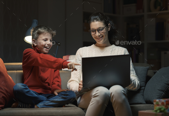 Mother and son watching movies on a laptop - Stock Photo - Images