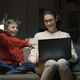 Mother and son watching movies on a laptop - PhotoDune Item for Sale
