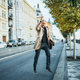 Mature businessman crossing street in city, jumping. - PhotoDune Item for Sale