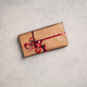 Gift or present in brown paper box with red ribbon, above view. - PhotoDune Item for Sale