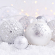 Christmas decorative balls on snow and Christmas lights. Festive - PhotoDune Item for Sale
