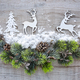 Christmas composition with deers and spruce branches on a wooden - PhotoDune Item for Sale