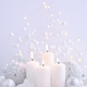 Christmas candles on the snow and Christmas lights. Festive Chri - PhotoDune Item for Sale