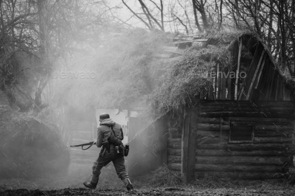 German Wehrmacht Infantry Soldier In WW II Running On Battlefiel - Stock Photo - Images
