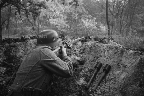 German Wehrmacht Infantry Soldier In World War II Hidden Sitting - Stock Photo - Images