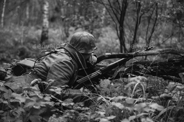 German Wehrmacht Infantry Soldier In World War II Hidden Sitting - Stock Photo - Images