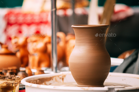 Pottery Craft Wheel And Ceramic Clay Pot. Traditional New Handma - Stock Photo - Images