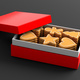 Christmas gingerbread cookies, red gift box, black background. - PhotoDune Item for Sale