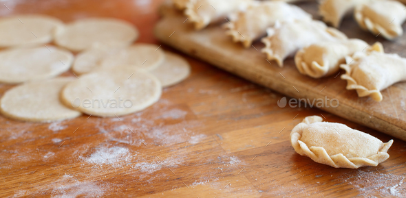 Raw meat pelmeni, ravioli, dumplings - Stock Photo - Images