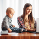 Mother and little kid looks on laptop screen - PhotoDune Item for Sale