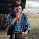 Brutal cowboy smokes a cigar, wild west culture - PhotoDune Item for Sale