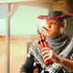 Cowboy lights a cigar from a stick of dynamite - PhotoDune Item for Sale