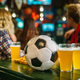 Ball and beer on the table in sports bar - PhotoDune Item for Sale