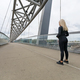 Fitness woman runner rests before running intervall workout on bridge - PhotoDune Item for Sale