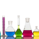 Laboratory glassware with colorful liquids on white background - PhotoDune Item for Sale
