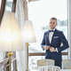 Free Download elegant groom in a hotel room Nulled