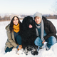 A couple enjoying winter while walking their big black dog havin - PhotoDune Item for Sale