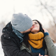 A happy young man and woman kissing in winter enjoying life and - PhotoDune Item for Sale