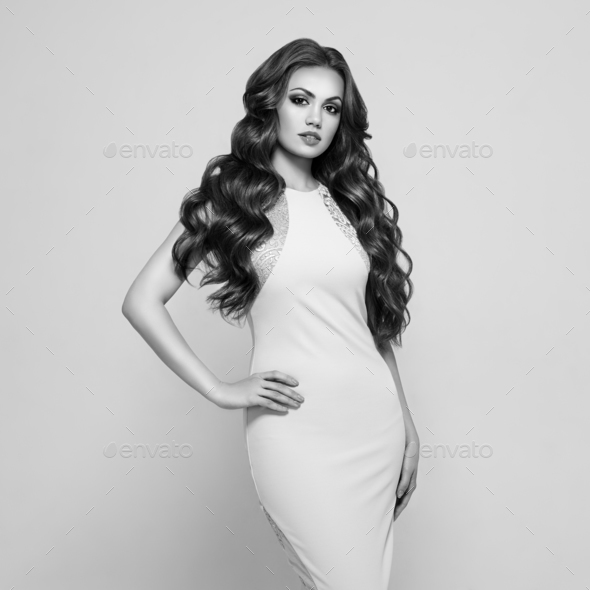 Beautiful woman in elegant white evening dress - Stock Photo - Images
