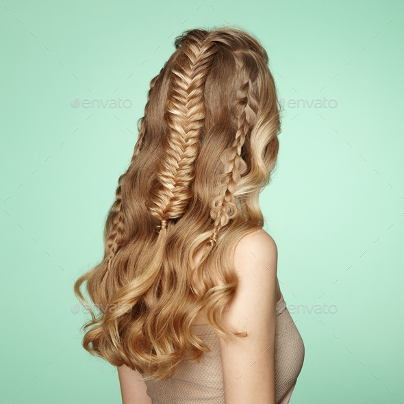 Blonde girl with long and shiny curly hair - Stock Photo - Images