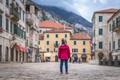 Girl in a waterproof jacket in Kotor Old Town - PhotoDune Item for Sale