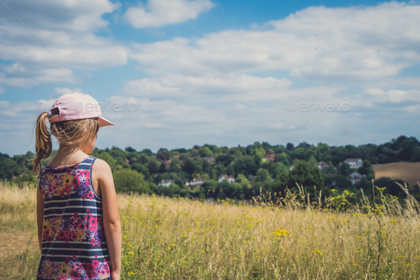 Girl looking at Surrey countryside - Stock Photo - Images