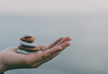 Pile of stacked stones in human hand - PhotoDune Item for Sale