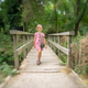 Cute girl crossing wooden bridge - PhotoDune Item for Sale