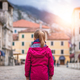 Girl in a waterproof jacket in Kotor Old Town - PhotoDune Item for Sale