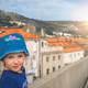 Little girl sightseeing Old Town in Dubrovnik - PhotoDune Item for Sale
