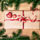 Gift or present in brown paper box over green background - PhotoDune Item for Sale