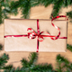 Christmas gift on wooden board with fir tree, red bells. - PhotoDune Item for Sale