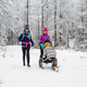 Mother with baby stroller enjoying winter in forest, family time - PhotoDune Item for Sale
