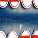 White and red sneakers on a the ripped denim background. - PhotoDune Item for Sale