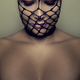 Beautiful Blonde Woman With Closed Eyes and Black Mesh On Her Face - PhotoDune Item for Sale