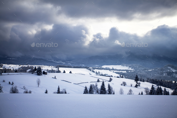 Wooden houses under snow - Stock Photo - Images