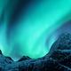 Aurora borealis above the snow covered mountain peak - PhotoDune Item for Sale