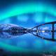 Bridge and aurora borealis over snowy mountains - PhotoDune Item for Sale