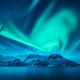 Aurora borealis above the snow covered mountain - PhotoDune Item for Sale