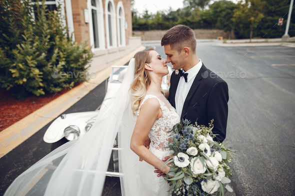 Couple near old car - Stock Photo - Images