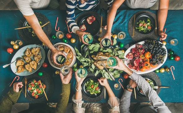 Company of friends or family celebrating Christmas together - Stock Photo - Images