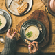 Free Download Celery cream soup and female hands with bread, square crop Nulled