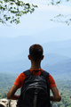 Boy with backpack on mountains background - PhotoDune Item for Sale